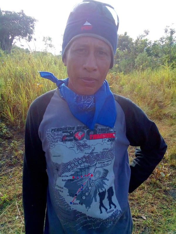 Bapak Haris was extremely helpful and here he is wearing a shirt made for the 200-year anniversary and showing the two possible trails for approaching the volcano - the one from Pancasila and the one from Doropeti, which I was planning to take.