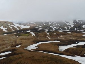 Hiking in July in the Icelandic highlands. Come to Iceland please but come prepared.